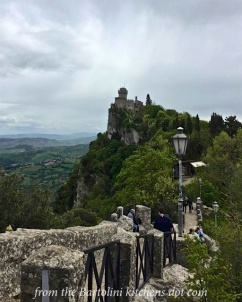 Walking along the wall to another tower of San Marino